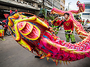 "05 JULY 2014 - BANGKOK, THAILAND:  Chinese style dragon dancers perform on a side street in Bangkok during a parade for vassa. Vassa, called ""phansa"" in Thai, marks the beginning of the three months long Buddhist rains retreat when monks and novices stay in the temple for periods of intense meditation. Vassa officially starts July 11 but temples across Bangkok are holding events to mark the holiday all week.   PHOTO BY JACK KURTZ"
