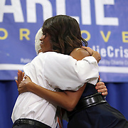 """First Lady Michelle Obama hugs Charlie Crist after speaking at his grassroots """"Commit to Vote"""" rally at the Barnett Park Gymnasium in Orlando, Florida on Friday, Nov. 17, 2014. (AP Photo/Alex Menendez)"""