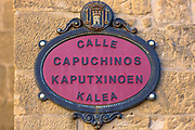 Street sign Calle Capuchinos in Spanish and Euskera Basque language in Basque town of Laguardia in Rioja-Alavesa area of Spain