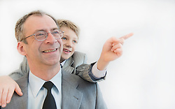Son showing something to his father, smiling