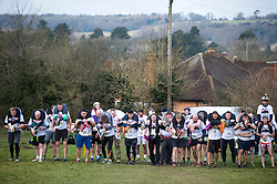 © Licensed to London News Pictures. 06/03/2016. Dorking, UK. Competitors line up to take part in the 2016 Wife Carrying Race in Dorking, Surrey.  The race, which is run over a course of 380m, with both men and women carry a 'wife' over obstacles,  is believed to have originated in the UK over twelve centuries ago when Viking raiders rampaged into the northeast coast of  England carrying off any unwilling local women .  Photo credit: Ben Cawthra/LNP