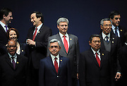 Prime Minister Stephen Harper, middle, takes part in the family photo at the Nuclear Security Summit in Seoul, Korea on Tuesday, March 27, 2012. THE CANADIAN PRESS/Sean Kilpatrick