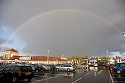 Rainbow over Tesco store car park, Martlesham, Suffolk, England