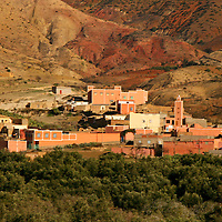 North Africa, Africa, Morocco. Small village settlements dot the landscape of Morocco and the foothills of the Atlas Mountains.