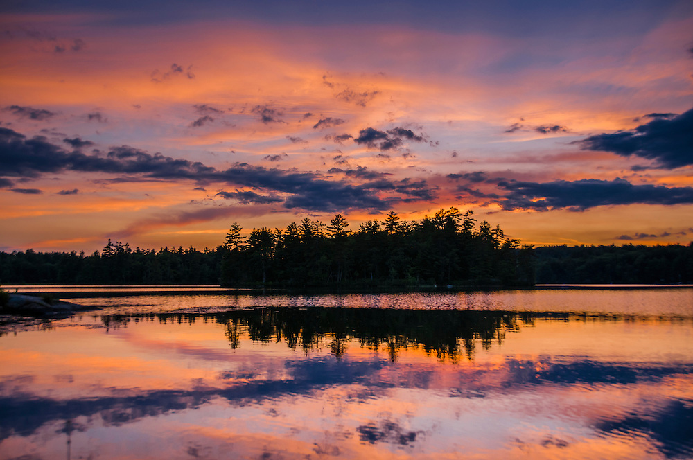 Dusk colors and cloud patterns reflected in lake, Meredith, NH