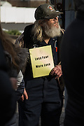 """Sunbury, Pennsylvania (December 23, 2016) -- A man holds a sign reading """"less fear, more love"""" outside the Sunbury Islamic Center. Local faith leaders organized a gathering in support of their Muslim neighbors after anti-Muslim, white supremacist fliers were found outside the building earlier in the week."""