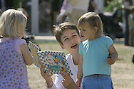 A woman and her children enjoy reading in the sunshine on the first day of the Edinburgh International Book Festival. The Book Festival was the World's largest literary event and featured writers from around the world. The 2006 event featured around 550 writers and ran from 13-28 August.