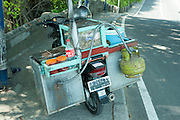 Food vendor's motorbike . . . complete with gas-powered hotplate.