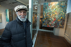 """Bill Dallas, whose show of paintings entitled """"Artmastism and Geometric Abstractions"""" is currently on display at the Joyce Gordon Gallery in Oakland, Calif., poses for a photograph outside the gallery Thursday, Sept. 29, 2016. (Photo by D. Ross Cameron)"""