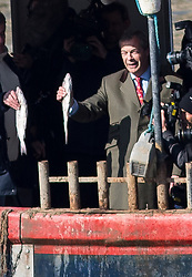 © Licensed to London News Pictures. 21/03/2018. London, UK. Former Leader of UKIP Nigel Farage and campgainers from the 'Fisherman for Leave' campaign onboard a fishing vessel, on the river Thames, London. Fishermen, many of whom who voted for Britain to leave the EU, are angry at yesterday's announcement that Britain will effectively continue to be involved in the EU's Common Fisheries Policy. Photo credit : Tom Nicholson/LNP