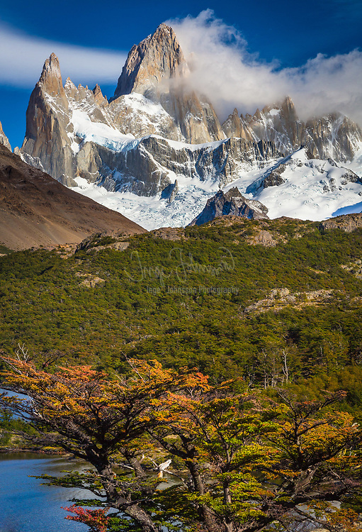 Fitz Roy towering high above Laguna Capri in Patagonia, Argentina. Monte Fitz Roy (also known as Cerro Chaltén, Cerro Fitz Roy, or simply Mount Fitz Roy) is a mountain located near El Chaltén village, in the Southern Patagonian Ice Field in Patagonia, on the border between Argentina and Chile. First climbed in 1952 by French alpinists Lionel Terray and Guido Magnone, it remains among the most technically challenging mountains on Earth for mountaineers. Monte Fitz Roy is the basis for the Patagonia clothing logo following Yvon Chouinard's ascent and subsequent film in 1968.