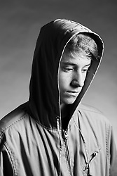 A teenage boy in pensive mood  as he poses in a photography studio at Fish Hoek, Cape Town, Western Cape, South Africa.(Picture: JULIAN GOLDSWAIN)