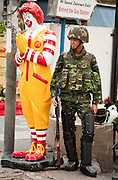 17 MAY 2010 - BANGKOK, THAILAND: A Thai soldier on duty at the McDonald's on Sukhumvit at Soi 4 in central Bangkok Monday. The Thai army has taken up positions up and down Sukhumvit to keep anti-government protesters out of the area. The anti-government protesters already control long stretches of both of the main roads that run parallel to Sukhumvit, making Sukhumvit the only secure access to central Bangkok. PHOTO BY JACK KURTZ
