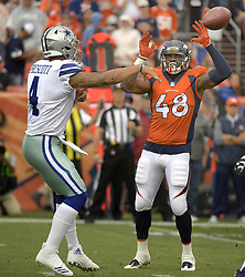 September 17, 2017 - Denver, CO, USA - Dallas Cowboys quarterback Dak Prescott (4) passes over Denver Broncos outside linebacker Shaquil Barrett (48) during the first quarter on Sunday, Sept. 17, 2017 at Sports Authority Field at Mile High in Denver, Colo. (Credit Image: © Max Faulkner/TNS via ZUMA Wire)