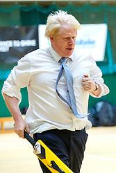 © Licensed to London News Pictures. 10/07/2015. London, UK. Boris Johnson takes part in a street cricket tournament at Hillingdon Sports and Leisure Complex in Uxbridge, London on Friday, July 10, 2015. The Mayor of London playing the game to support grassroots sports for community cohesion as the Ashes gets under way. Photo credit: Tolga Akmen/LNP