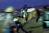 EEUU. Nuevo México. Espanola<br /> Rodeo nocturno en la ciudad de Espanola<br /> <br /> USA. New Mexico. Espanola<br /> A rider during a night rodea at Espanola<br /> <br /> ©JOAN COSTA
