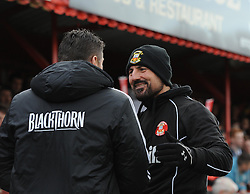 Bristol City manager, Steve Cotterill is greeted by Tamworth Manager, Dale Belford- Photo mandatory by-line: Joe Meredith/JMP - Tel: Mobile: 07966 386802 08/12/2013 - SPORT - Football - Tamworth - The Lamb Ground - Tamworth v Bristol City - FA Cup - Second Round