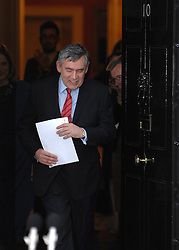 © under license to London News Pictures. LONDON. 05/05/2011. One year on since the last General Election. FILE PICTURE DATED 11/05/10. Gordon Brown emerges into the street, carrying his resignation speech, to applause from staff inside number 10 Downing Street. British Prime Minister Gordon Brown has resigned his position and David Cameron has become the new British Prime Minister on May 11, 2010. The Conservative and Liberal Democrats are to form a coalition government after five days of negotiation. Photo credit should read Stephen Simpson/LNP