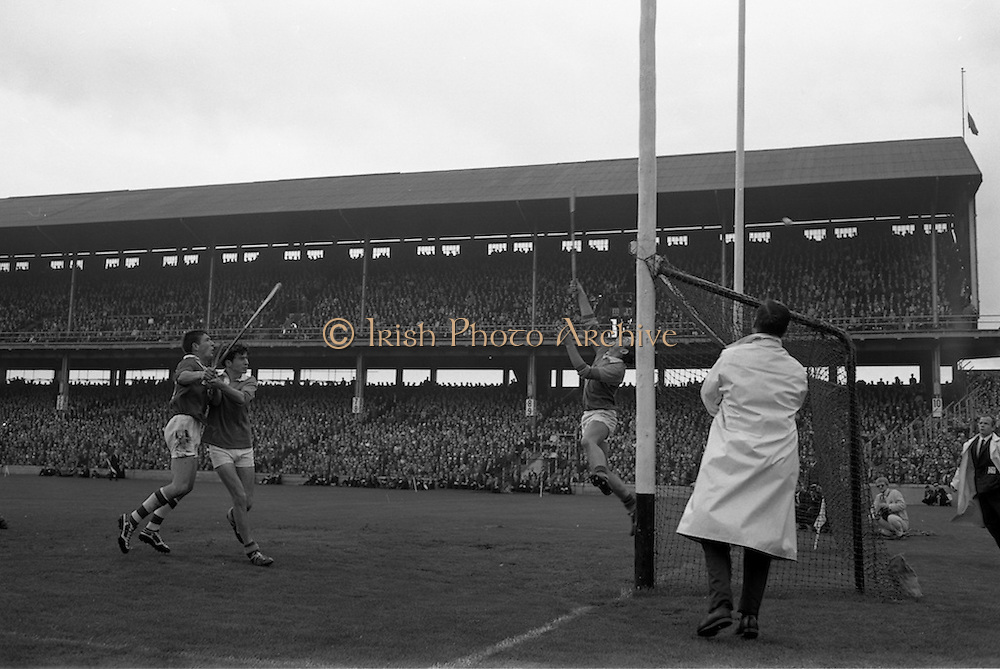 01/09/1968<br /> 09/01/1968<br /> 1 September 1968<br /> All-Ireland Minor Hurling Final: Cork v Wexford at Croke Park, Dublin.<br /> T. Buckley, being blocked by one of the Wexford backs, sends the ball over the bar for a point for Cork.