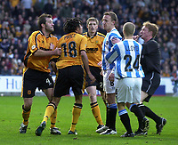 Photo. Glyn Thomas.<br /> Huddersfield Town v Hull City. Nationwide Division 3.<br /> The Alfred McAlpine Stadium, Huddersfield. 15/11/03.<br /> There are ugly scenes as Hull's Jason Price is confronted by Tony Carss, for which Carss was shown a yellow card.