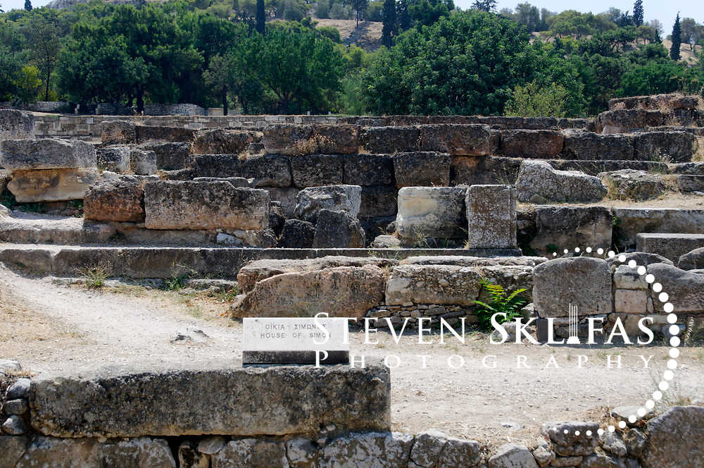 Ancient Agora. Athens. Greece. View of the excavated foundation of the 5th century BC house of Simon the Cobbler or shoemaker. It is believed that in this building Socrates engaged the local youth and students who were too young to enter the Agora proper in philosophical discussions and conversations.  It is said that Pericles also attended. It is also thought by some that Simon may have recorded the conversations in a book of dialogues called Cobblers talk, however we may never know. The Agora from 600 BC onwards was the commercial and social centre of Ancient Athens. It was here that laws were written and displayed, commercial goods bought and sold, intellectual discussions were had, and the democratic spirited was born and nurtured.