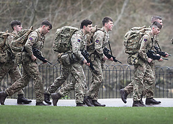 © Licensed to London News Pictures. 12/03/2018. London, UK. Members of the Coldstream Guards go on an exercise run with their weapons in St James's Park near Downing Street. Photo credit: Peter Macdiarmid/LNP