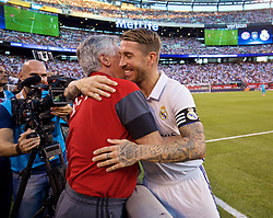 NEW JERSEY, USA - Wednesday, August 3, 2016: Real Madrid's Sergio Ramos embraces FC Bayern München's head coach Carlo Ancelotti take out in action against Bayern München before the International Champions Cup match at the Red Bull Arena. (Pic by David Rawcliffe/Propaganda)
