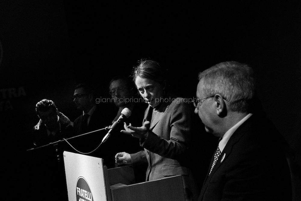 """BRINDISI, ITALY - 6 FEBRUARY 2013: Giorgia Meloni (36), founder and leader of the centre-right party """"Fratelli d'Italia"""" (Brothers of Italy) together with Guido Crosetto and Ignazio La Russa, rallies in Brindisi, Italy, during her campaign in Apulia on February 6 2013.<br /> <br /> A general election to determine the 630 members of the Chamber of Deputies and the 315 elective members of the Senate, the two houses of the Italian parliament, will take place on 24–25 February 2013. The main candidates running for Prime Minister are Pierluigi Bersani (leader of the centre-left coalition """"Italy. Common Good""""), former PM Mario Monti (leader of the centrist coalition """"With Monti for Italy"""") and former PM Silvio Berlusconi (leader of the centre-right coalition).<br /> <br /> ###<br /> <br /> LECCE, ITALIA - 6 FEBBRAIO 2013: Giorgia Meloni (36 anni), fondatrice e leader di """"Fratelli d'Italia"""" insieme a Guido Crosetto e Ignazio La Russa,  Giorgia Meloni (36), fa un comizio Brindisi durante la sue campagna electoral in Puglia il 6 fennraio 2013.<br /> Le elezioni politiche italiane del 2013 per il rinnovo dei due rami del Parlamento italiano – la Camera dei deputati e il Senato della Repubblica – si terranno domenica 24 e lunedì 25 febbraio 2013 a seguito dello scioglimento anticipato delle Camere avvenuto il 22 dicembre 2012, quattro mesi prima della conclusione naturale della XVI Legislatura. I principali candidate per la Presidenza del Consiglio sono Pierluigi Bersani (leader della coalizione di centro-sinistra """"Italia. Bene Comune""""), il premier uscente Mario Monti (leader della coalizione di centro """"Con Monti per l'Italia"""") e l'ex-premier Silvio Berlusconi (leader della coalizione di centro-destra).BRINDISI,  ITALY - 6 FEBRUARY 2013: Giorgia Meloni (36), founder and leader of the centre-right party """"Fratelli d'Italia"""" (Brothers of Italy) together with Guido Crosetto and Ignazio La Russa, rallies in Brindisi, Italy, during her campaign in Apulia on February 6 2013.<br /> <b"""