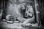 Heavens Gate - Black and white art photo of the stone sculpture of a nude looking at a skull on a crucifix.  Sculpted in an art Nouveau style the sculture is a reminder that beauty and life is transient. The Lavarello tomb sculpted by Demetrio Paernio 1914. The monumental tombs of the Staglieno Monumental Cemetery, Genoa, Italy .<br /> <br /> Visit our PEOPLE & PLACES PHOTO ART COLLECTIONS for more photos to buy as buy as wall art prints https://www.photoshelter.com/mem/images/index#/C00001WetsxVxNTo/ .<br /> <br /> Visit our LANDSCAPE PHOTO ART PRINT COLLECTIONS for more wall art photos to browse https://funkystock.photoshelter.com/gallery-collection/Places-Landscape-Photo-art-Prints-by-Photographer-Paul-Williams/C00001WetsxVxNTo