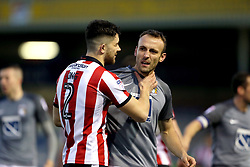 Lincoln City's Sean Long (left) and Coventry City's Liam Kelly clash