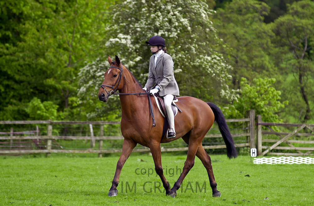 Young female rider competing in equine event Cotswolds, Oxfordshire, UK