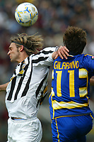 Parma 18/4/2004 Campionato Italiano Serie A <br />30a Giornata - Matchday 30 <br />Parma Juventus 2-2 <br />Nicola Legrottaglie (Juventus) and Alberto Gilardino (Parma)<br /> Foto Graffiti