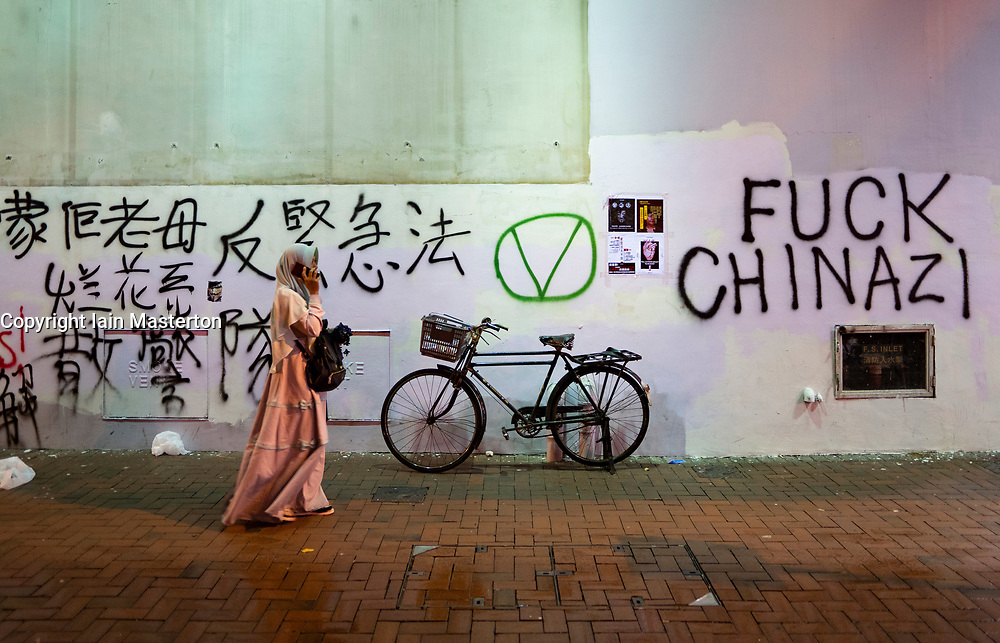 Hong Kong. 6 October 2019. Tens of thousands of pro-democracy protestors march in pouring rain through centre of Hong Kong today from Causeway Bay to Central. Peaceful march later turned violent as a hard-core of protestors confronted police. Pic; Graffiti on walI of local market in Wanchai. Iain Masterton/Alamy Live News.