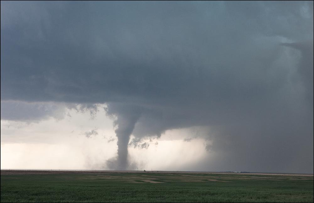 Fully condensed tornado in an open field near Eads, Colorado.