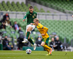 DUBLIN, REPUBLIC OF IRELAND - Sunday, October 11, 2020: Wales' Matthew Smith (R) and Republic of Ireland's Conor Hourihane during the UEFA Nations League Group Stage League B Group 4 match between Republic of Ireland and Wales at the Aviva Stadium. The game ended in a 0-0 draw. (Pic by David Rawcliffe/Propaganda)