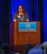 Laura Morales comments during the Scholars Banquet at the Westin Galleria, April 11, 2017.