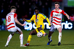 Jeffrey Schlupp of Crystal Palace takes on Ben Whiteman and Danny Andrew of Doncaster Rovers - Mandatory by-line: Robbie Stephenson/JMP - 17/02/2019 - FOOTBALL - The Keepmoat Stadium - Doncaster, England - Doncaster Rovers v Crystal Palace - Emirates FA Cup fifth round proper