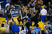 Golden State Warriors guard Stephen Curry (30) is picked up by him teammates after being fouled by the Dallas Mavericks at Oracle Arena in Oakland, California, on February 8, 2018. (Stan Olszewski/Special to S.F. Examiner)