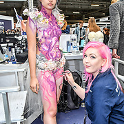 Airbrush body painting by guest artist Kate Monroe at IMATS on 18 May 2019,  London, UK.