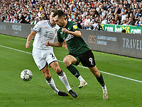 Football - 2021 / 2022 EFL Carabao Cup - Round Two - Swansea City vs Plymouth Argyle - Liberty Stadium - Tuesday 24th August 2021<br /> <br /> Ryan Hardie Plymouth Argyleon the attack Ryan Bennett Swansea City defends <br /> <br /> COLORSPORT/WINSTON BYNORTH