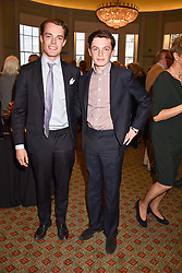 Left to right, brothers The Marquess of Granby and Lord Hugo Manners sons of the 11th Duke of Rutland at a party to celebrate the publication of Resolution by The Duke of Rutland and Emma Ellis held at Trinity House, Tower Hill, London England. 10 April 2017.