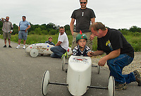 Team Keyser and Son receiving pre-race advice #74 Justin Vayda with Shawn Vayda and # 27 Brady Palmer with Les and Butch Keyser prior to running their heat in the 2nd annual Franklin Elks Soap Box Derby Saturday morning.  (Karen Bobotas/for the Laconia Daily Sun)