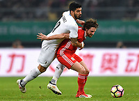 """Luis Suarez, left, of Uruguay national football team challenges a player of Wales national football team in their final match during the 2018 Gree China Cup International Football Championship in Nanning city, south China's Guangxi Zhuang Autonomous Region, 26 March 2018.<br /> <br /> Edinson Cavani's goal in the second half helped Uruguay beat Wales to claim the title of the second edition of China Cup International Football Championship here on Monday (26 March 2018). """"It was a tough match. I'm very satisfied with the result and I think that we can even get better if we didn't suffer from jet lag or injuries. I think the result was very satisfactory,"""" said Uruguay coach Oscar Tabarez. Wales were buoyed by a 6-0 victory over China while Uruguay were fresh from a 2-0 win over the Czech Republic. Uruguay almost took a dream start just 3 minutes into the game as Luis Suarez's shot on Nahitan Nandez cross smacked the upright. Uruguay were dealt a blow on 8 minutes when Jose Gimenez was injured in a challenge and was replaced by Sebastian Coates. Inter Milan's midfielder Matias Vecino of Uruguay also fired at the edge of box from a looped pass but only saw his attempt whistle past the post. Suarez squandered a golden opportunity on 32 minutes when Ashley Williams's wayward backpass sent him clear, but the Barca hitman rattled the woodwork again with goalkeeper Wayne Hennessey well beaten."""
