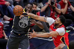 May 6, 2018 - New Orleans, LA, U.S. - NEW ORLEANS, LA - MAY 06:  Golden State Warriors forward Draymond Green (23) passes the ball against New Orleans Pelicans forward Anthony Davis (23) during game 4 of the NBA Western Conference Semifinals at Smoothie King Center in New Orleans, LA on May 06, 2018.  (Photo by Stephen Lew/Icon Sportswire) (Credit Image: © Stephen Lew/Icon SMI via ZUMA Press)