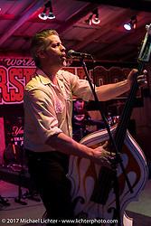 "Rob ""Bobcat"" Bundy slapping the double bass as the Razorbacks Rock-A-Billy band play the Iron Horse Saloon during Daytona Bike Week. Ormond Beach, FL, USA. Thursday March 9, 2017. Photography ©2017 Michael Lichter."