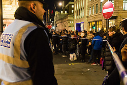 London, November 24 2017. Oxford Circus is sealed off after reports of an incident, creating havoc for traffic and underground commuters during Friday's rush hour, with police eventually standing down. Social media reports mentioned shots fired although this appears now not to be the case PICTURED: Crowds are held back by police cordons two blocks from the Oxford Circus. © Paul Davey