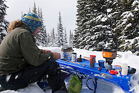Preparing meals on makeshift table in a winter backcountry camp in Manning Provincvial Park British Columbia Canada