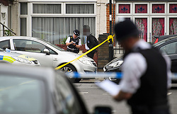 © Licensed to London News Pictures. 28/06/2018. London, UK. Police talk to residents at the scene where a 20 year old man was stabbed to death yesterday evening in Edmonton, North London. Police were called to reports of a row between men armed with baseball bats on Wednesday evening. Photo credit: Ben Cawthra/LNP
