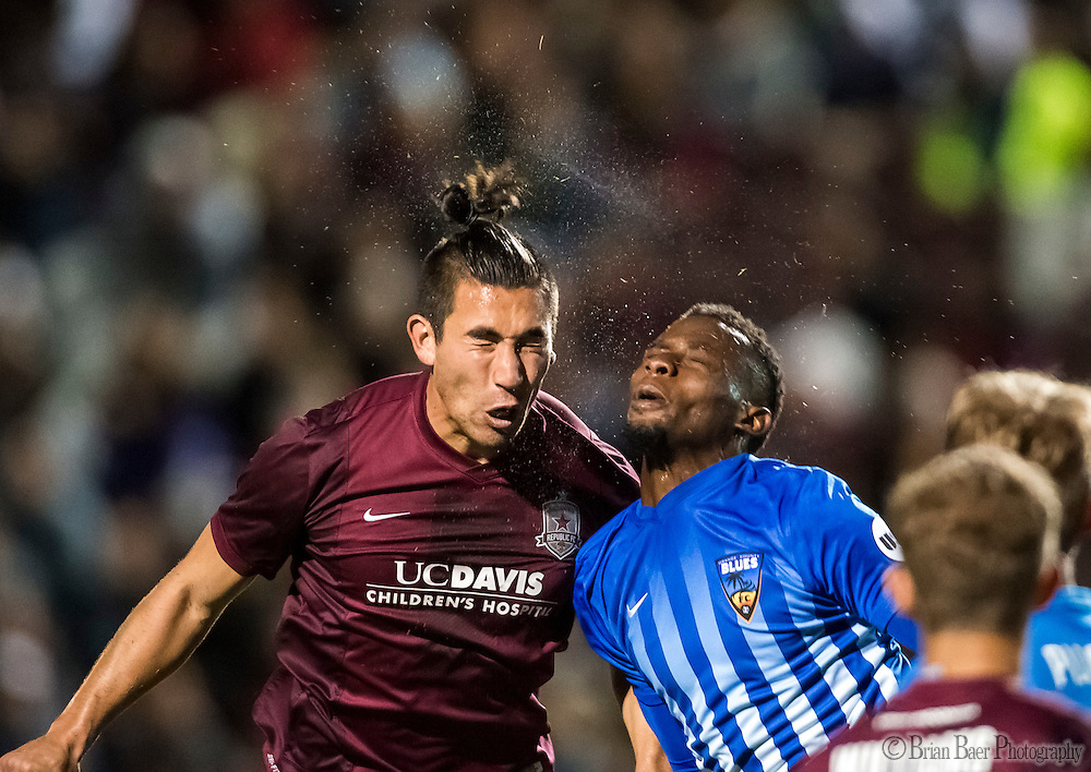 Sac Republic FC Cameron Iwasa (14), and Orange County Blues FC Brenton Griffiths (23), hit heads during the second half of the USL Western Conference first round playoff game between the Republic FC and the visiting Orange County Blues FC at Bonney Field, Saturday Oct 1, 2016.<br /> photo by Brian Baer