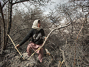 Fozia Parveen. Women go every day to get wood (for cooking and heating) in Zor Abad, a winter pasture two hour walk from Hussaini village, across the Hunza valley riverbed. Gojal region.